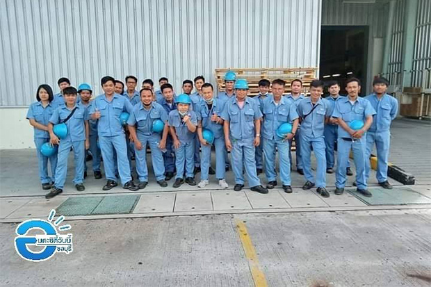 Some of the 689 workers laid off at Mitsubishi Elevator Asia pose for a photo on their last day of work at the Amata City Industrial Estate in Chon Buri on Wednesday. (Amata City Today Facebook account)