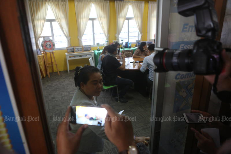 Parents press for assurances their children are being cared for in a safe environment from the management of Sarasas Witaed Ratchaphruek School in Nonthaburi on Monday, following the beating of kindergarteners by their carers. (Photo by Pattarapong Chatpattarasill)