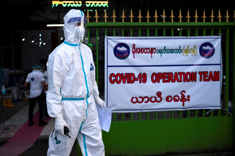 A volunteer wearing a protective suit stands as he waits to transfer suspect cases to a quarantine centre amid the outbreak of the novel coronavirus disease, in Yangon, Myanmar, on Saturday. (Reuters photo)