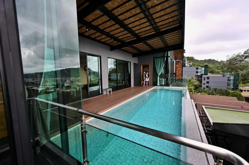 A villa converted for use as an alternative state quarantine (ASQ) room for incoming overseas tourists is seen at The Senses Resort in Phuket on Saturday. (AFP photo)