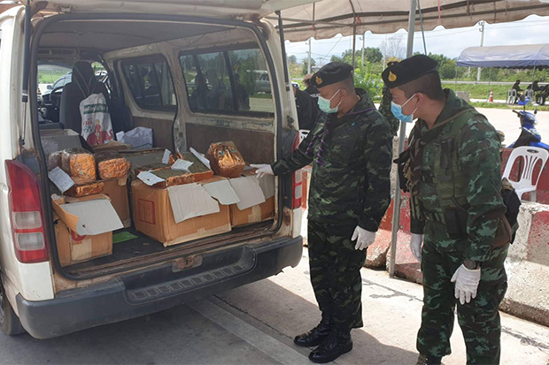 A soldier points at compressed marijuana found in a Myanmar van about to cross the border from Mae Sot district in Tak to Myawaddy on Monday. (Photo by Assawin Pinitwong)