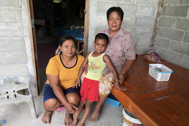 The family of Chai Bunthonglek, a farmer who was killed in 2015 in a community farm in Klong Sai Pattana in Surat Thani province in southern Thailand, Aug 24, 2020. (Photo: Thomson Reuters Foundation/Rina Chandran)