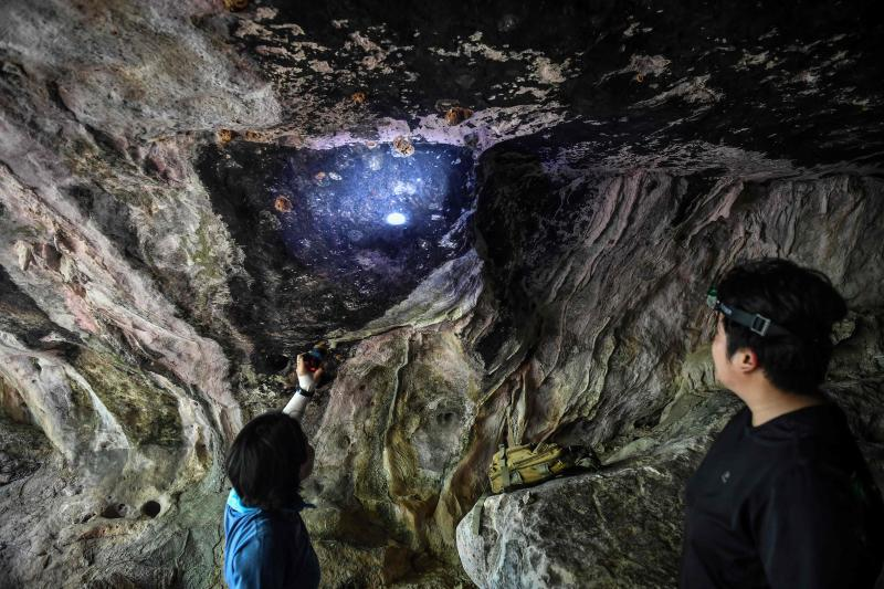 Archaeologists from the Fine Arts Department in Ratchaburi look at newly-discovered cave paintings in Khao Sam Roi Yot national park in coastal Prachuap Kiri Khan province, on Sept 10, 2020. (AFP photos)