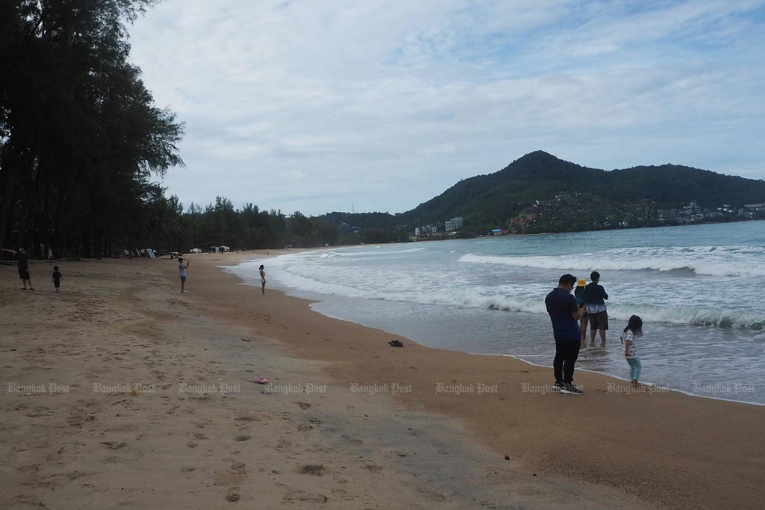 Local tourists at Kamala beach in Phuket. Most Phuket residents surveyed say they agree with a plan to reopen the country. (Photo by Dusida Worrachaddejchai)