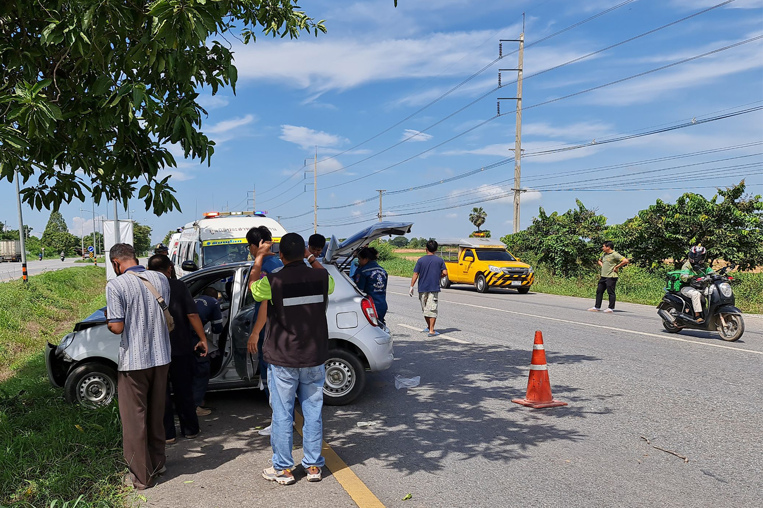 Emergency responders at the scene of the crash in Muang district of Phitsanulok on Wednesday. The driver's elderly parents were killed and his daughter seriously injured. (Photo: Chinnawat Singha)
