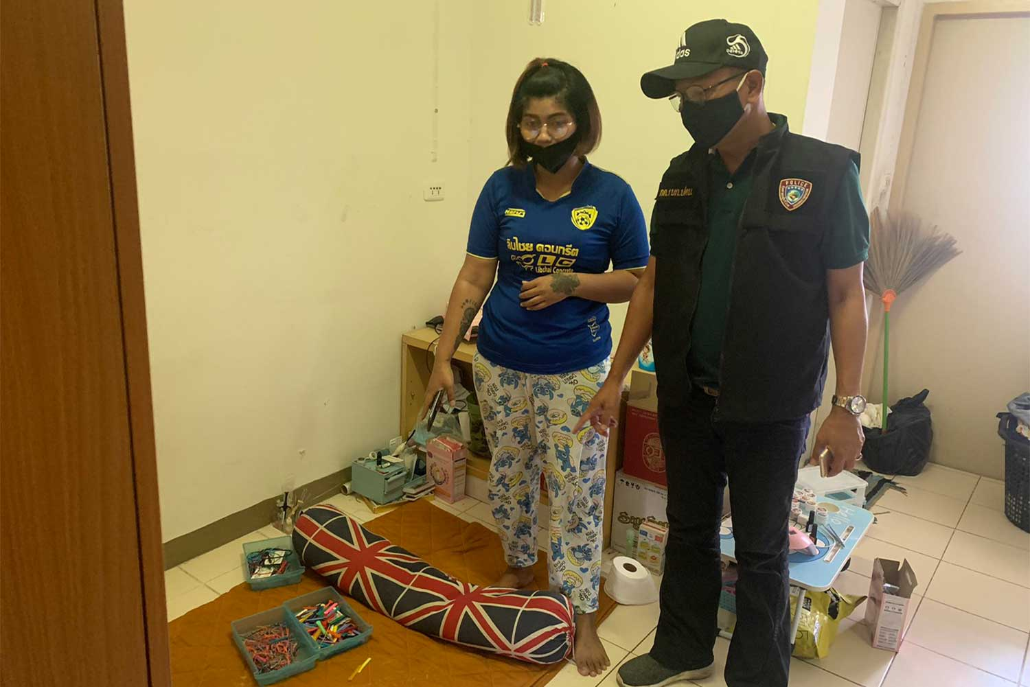 Natsuda Sriwichian, 30, of Buri Ram, pictured during her arrest in a room in Nakhon Pathom's Samphan district on Wednesday for illegaly selling and fitting fashionable teeth braces. (Photo supplied/Wassayos Ngamkham)