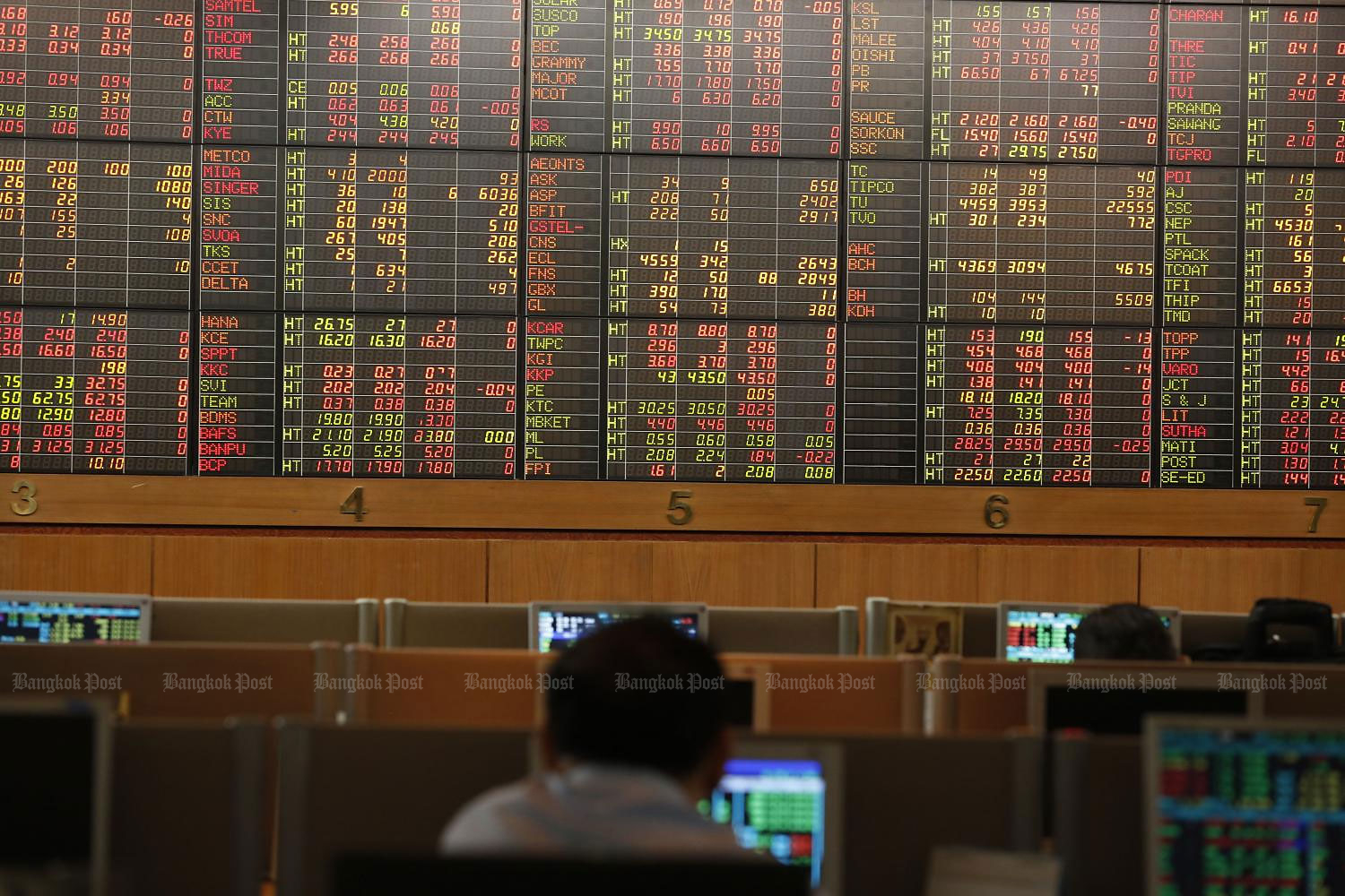 An investor looks at an electronic display of stock indices at Asia Plus Securities. (Photo by Pornprom Satrabhaya)