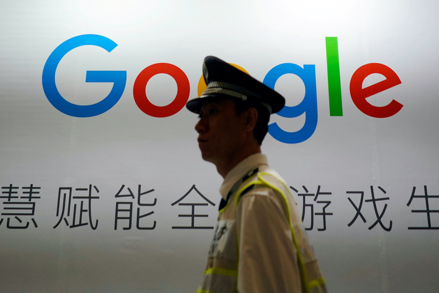 A security guard walks past a Google sign at the China Digital Entertainment Expo in Shanghai in 2018. (Reuters File Photo)