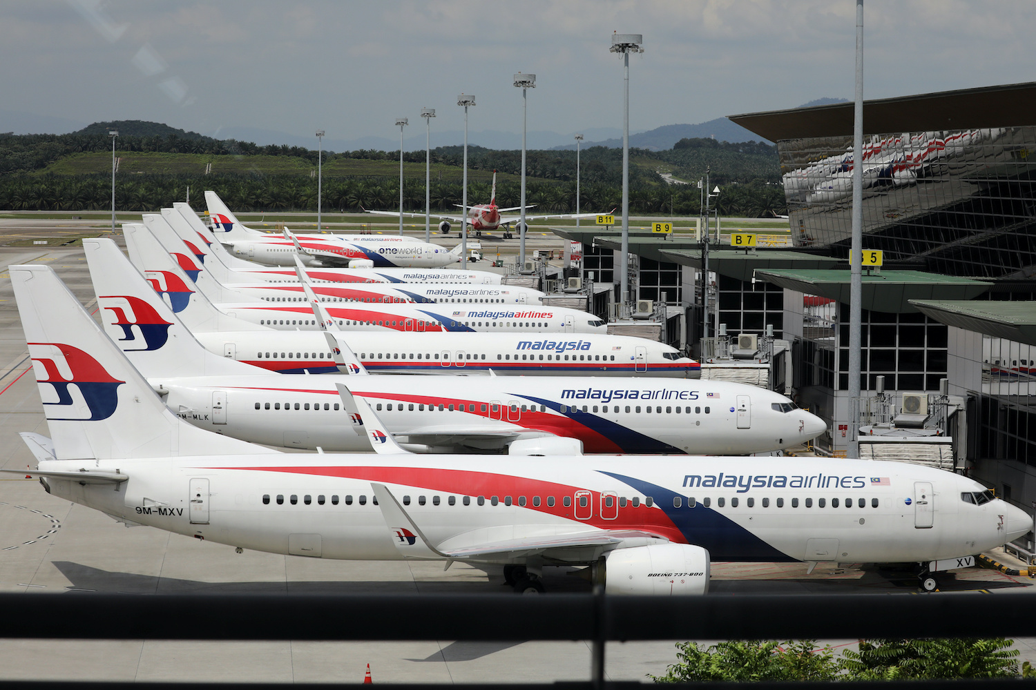 Malaysia Airlines jets are seen parked at Kuala Lumpur International Airport on Oct 6. (Reuters Photo)
