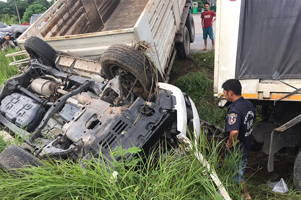 A SUV is seen overturned after it was hit by a truck in Tham Phannara district of Nakhon Si Thammarat on Sunday. (Photo by Nujaree Raekrun)