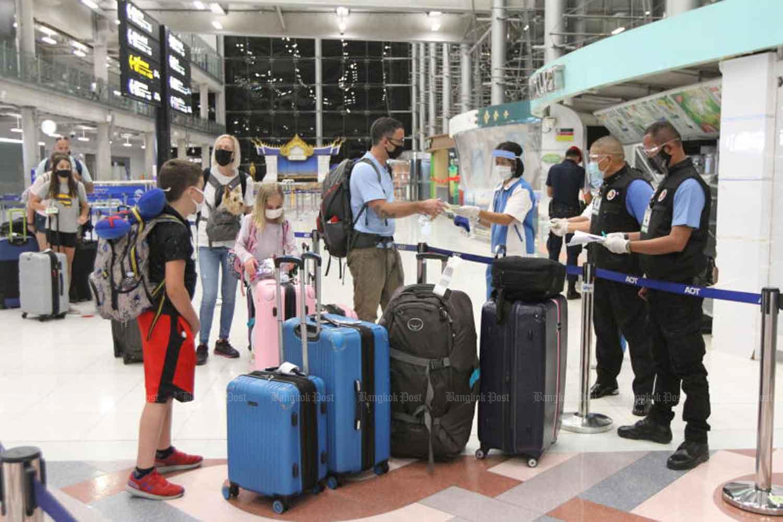 Diplomats and their family members arrive at Suvarnabhumi airport in Samut Prakan province in August. (Photo: Wichan Charoenkiatpakul)