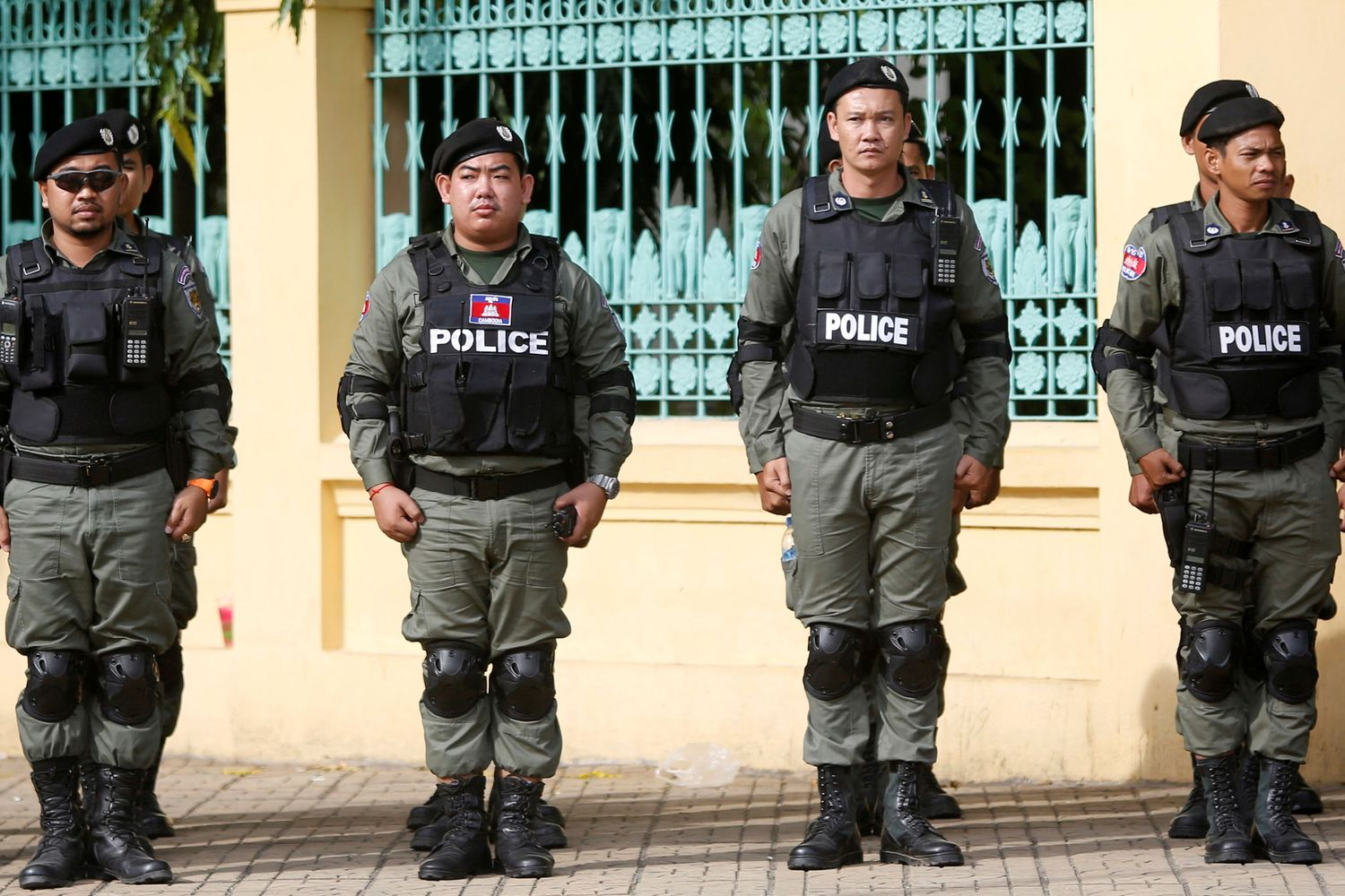 Police officers stand guard near the Supreme Court of Phnom Penh, Cambodia, in 2017. (Reuters photo)