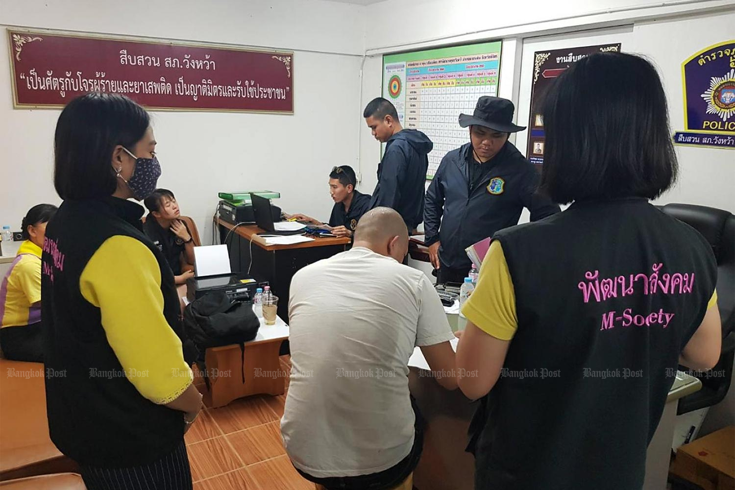 A man is arrested in Phitsanulok for forcing his 19-year-old girlfriend into group sex and selling her videos for customers via Twitter and Line. He was a Buddhist monk when the arrest took place.(Photo by Chinnawat Singha)