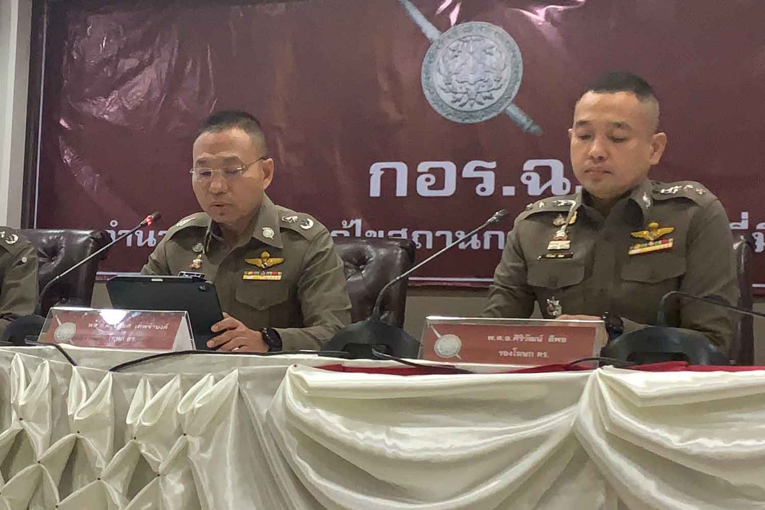 Pol Maj Gen Yingyot Thepjamnong, spokesman of the Royal Thai Police Office, left, and his deputy Pol Col Siriwat Deepor make their announcement at the Royal Thai Police Office in Bangkok on Friday. (Photo supplied)