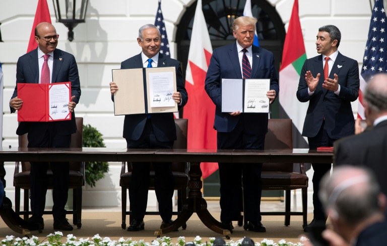 (L-R) Bahrain Foreign Minister Abdullatif al-Zayani, Israeli Prime Minister Benjamin Netanyahu, US President Donald Trump, and UAE Foreign Minister Abdullah bin Zayed Al-Nahyan signed the 'Abraham Accords' at the White House in September