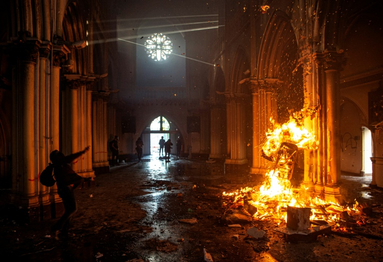 Demonstrators start a fire inside the San Francisco de Borja church in Santiago, Chile.