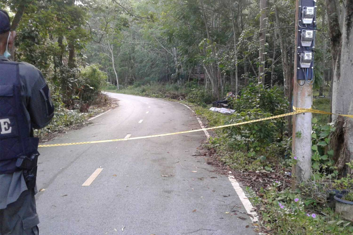 Crime scene tape cordons off the spot where an assistant village head was shot dead on Tuesday morning in Mayo district of Pattani. (Photo: Abdullah Benjakat)
