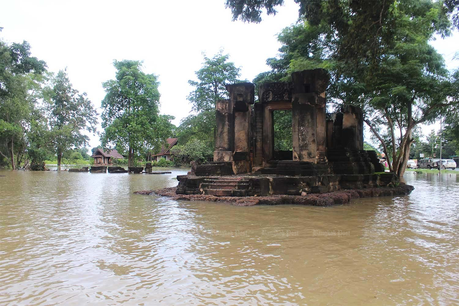 The 900-year-old Prang Phakho stone ruins in Chok Chai district and surrounding communities are under floodwater. (Photo by: Prasit Tangprasert)