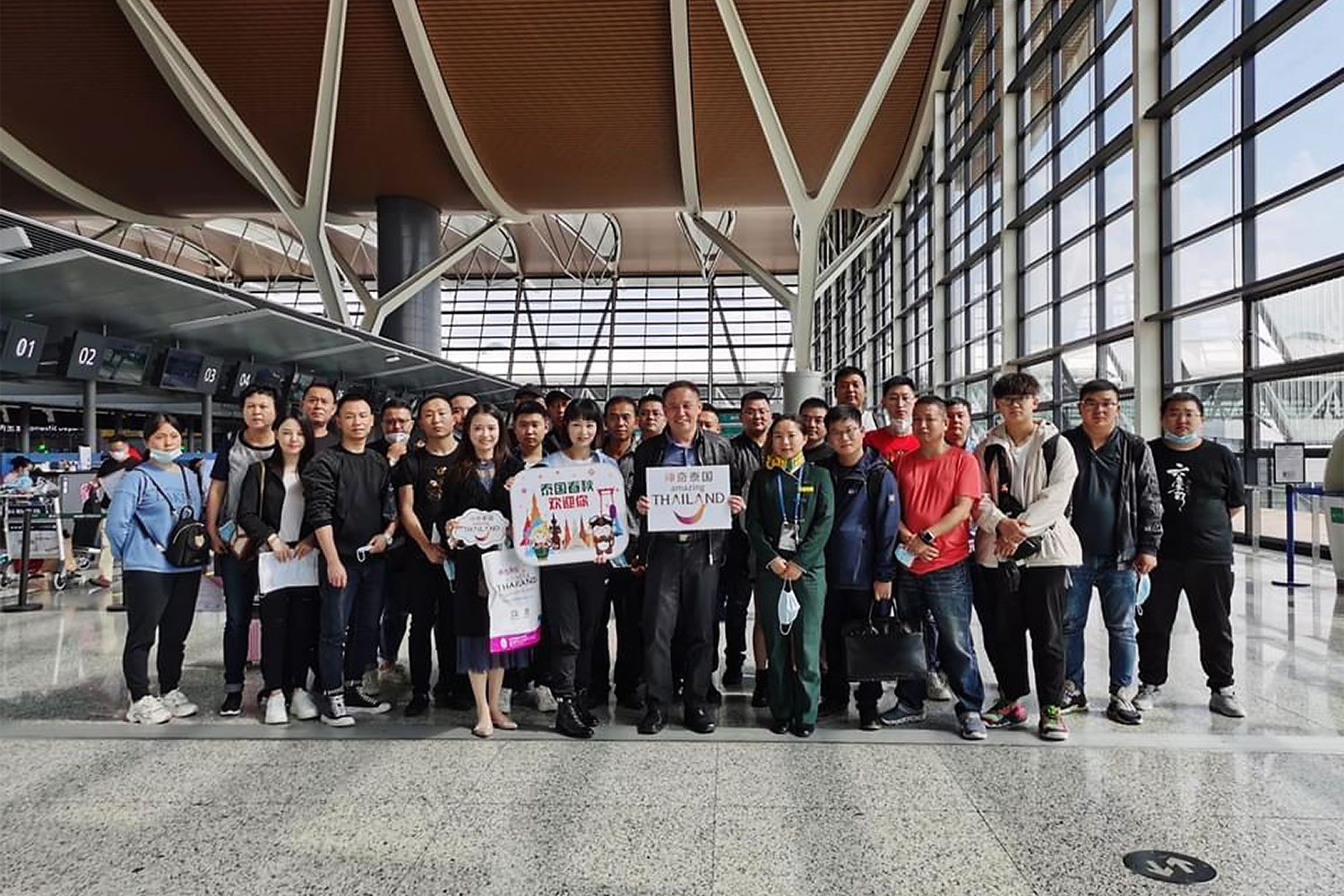 The first group of Chinese tourists under Thailand's STV scheme is shown before departing from Shanghai.