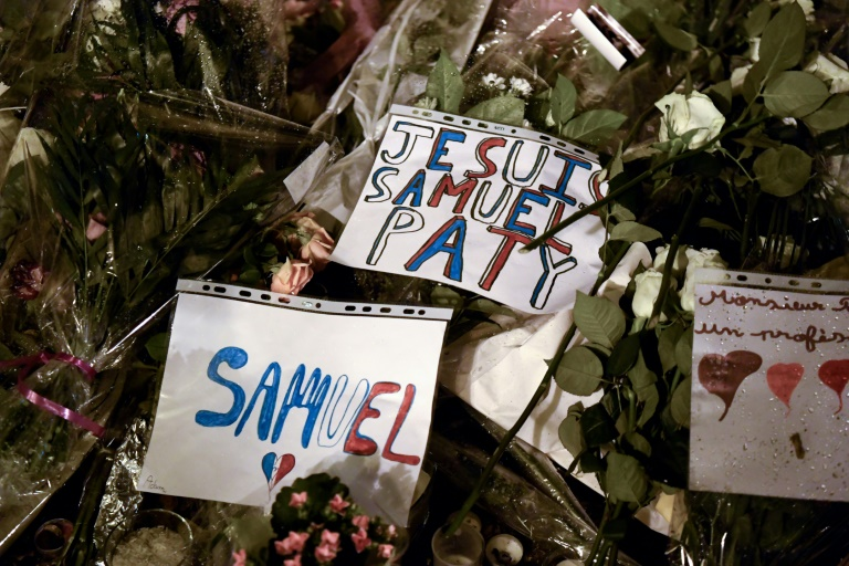 Thousands marched Tuesday in the suburb of Conflans-Sainte-Honorine where murdered teacher Samuel Paty worked.