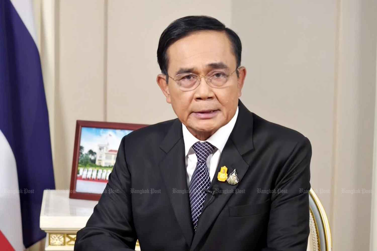 Prime Minister Prayut Chan-o-cha appears in a TV Pool address last night promising to lift the state of emergency.(Photo by Pattanapong Hirunard)