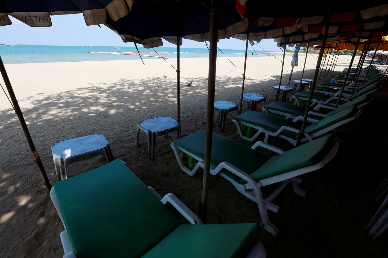 Empty chairs are seen on a beach, which is usually full of tourists, amid fears of coronavirus disease in Pattaya on March 27. (Reuters photo)