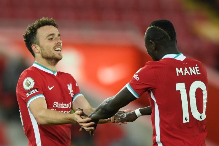 Liverpool forward Diogo Jota (left) celebrates his winner against Sheffield United.