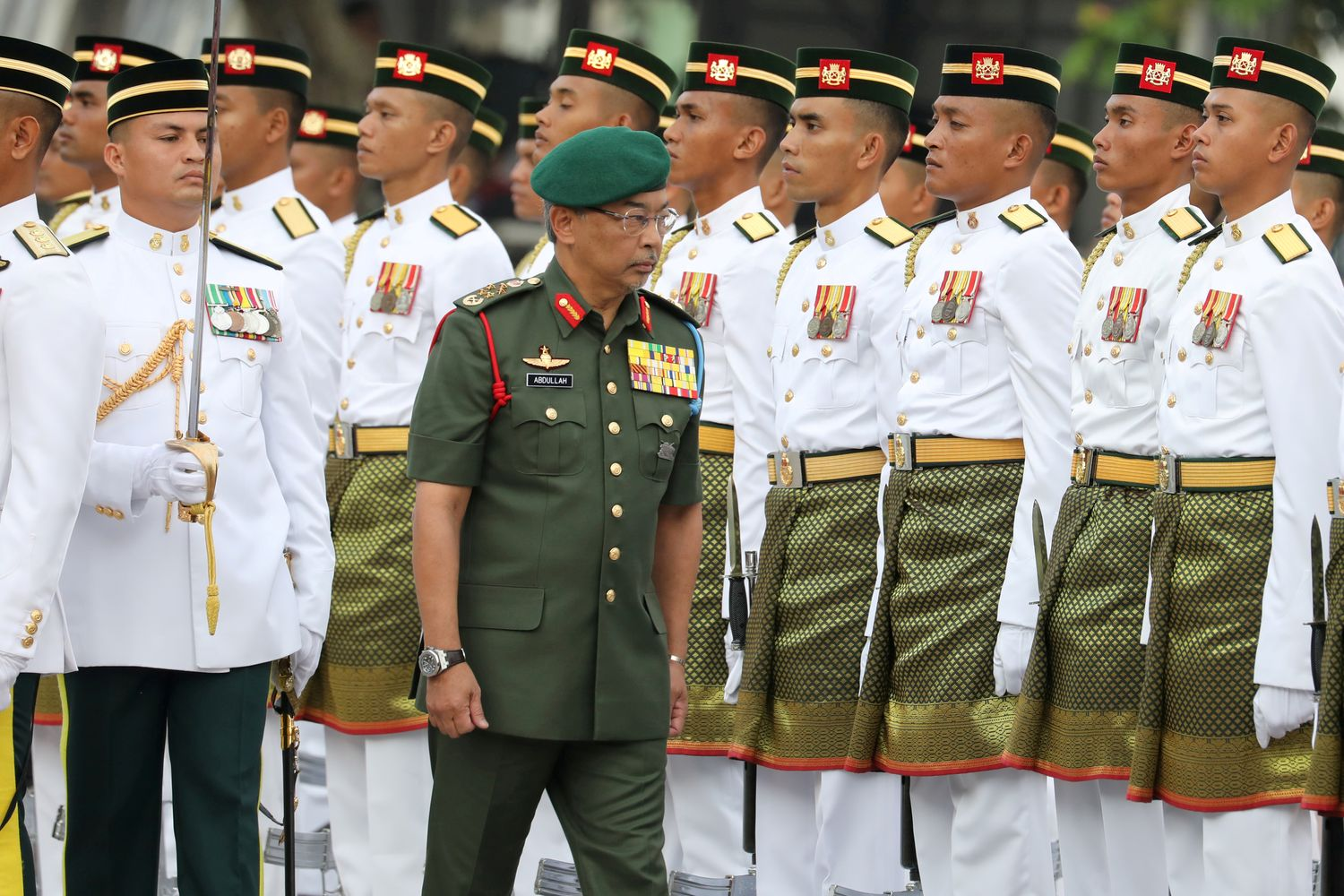 Malaysia's King, Al-Sultan Abdullah inspects a guard of honour during the 62nd Independence Day celebrations in Putrajaya, Malaysia, last August. (Reuters photo)