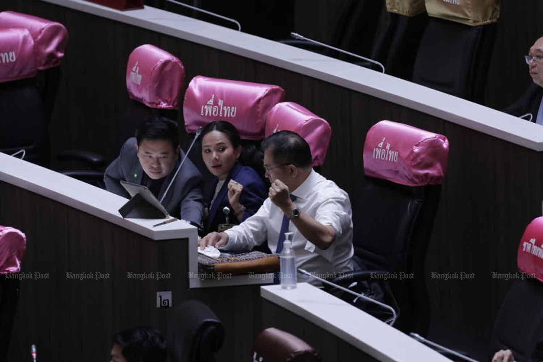 Pheu Thai MP Wisarn Techateerawat (right) cut his arm during a parliament debate on Tuesday night. (Photo by Pornprom Satrabhaya)