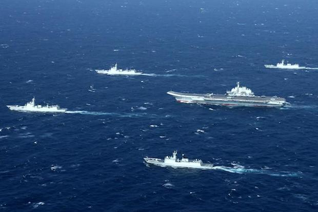 This aerial file photo taken on Jan 2, 2017 shows a Chinese Navy formation, including the aircraft carrier Liaoning (centre), during military drills in the South China Sea. (AFP)