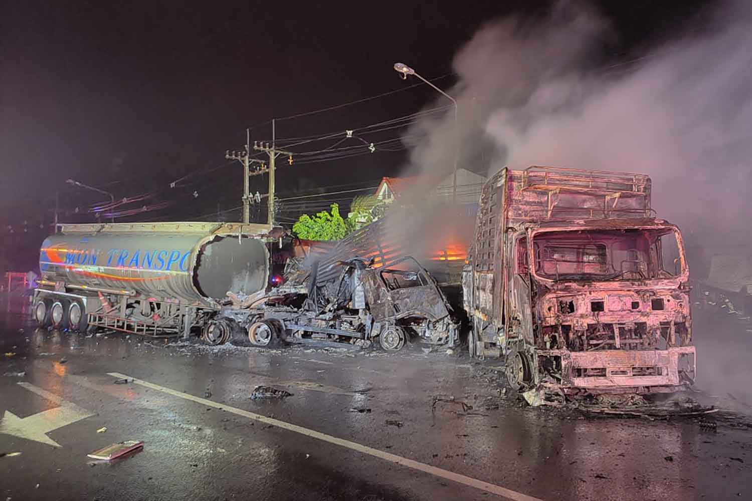 The burning fuel tanker and trailer truck after the collision in Nong Ki district, Buri Ram, early Thursday morning. (Photo: Surachai Piragsa)