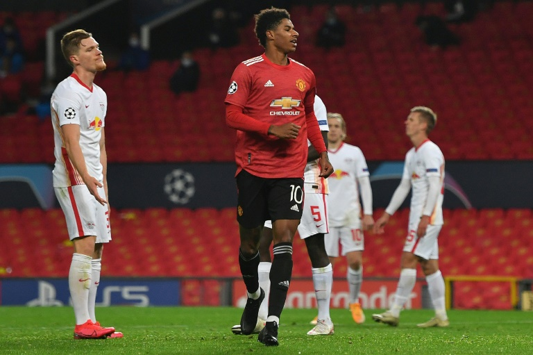 Marcus Rashford celebrates scoring his third goal and Manchester United's fifth in their big win over RB Leipzig.