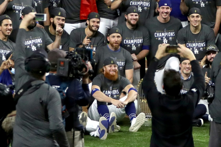 LA Dodgers star Justin Turner sits with team-mates after the World Series victory, despite being told to isolate after a positive Covid-19 case.