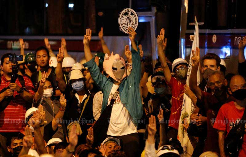 Demonstrators show the three-fingered salute during a protest outside the German embassy on Monday. (Reuters photo)