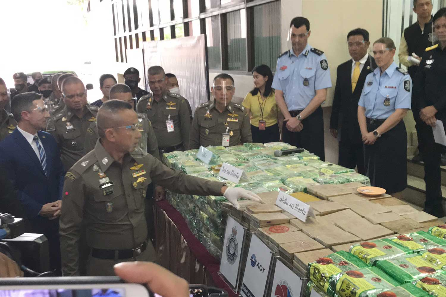 Narcotics Suppression Bureau officers display drugs seized in eight cases, including 1,470kg of crystal meth and 431kg of heroin, at a briefing on Friday in Bangkok. (Supplied photo)