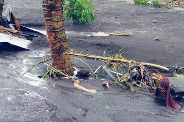 A body is seen buried in mud in the aftermath of Typhoon Goni in Albay province, Philippines, on Sunday in this picture obtained from social media. Marychris Olavario-Cuachin/via Reuters)
