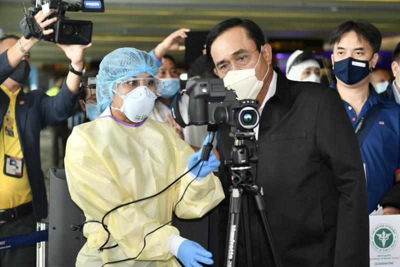 Prime Minister Prayut Chan-o-cha checks the screening process at Phuket Airport on Monday after he arrived on the island to hold a cabinet meeting. (Government House photo)