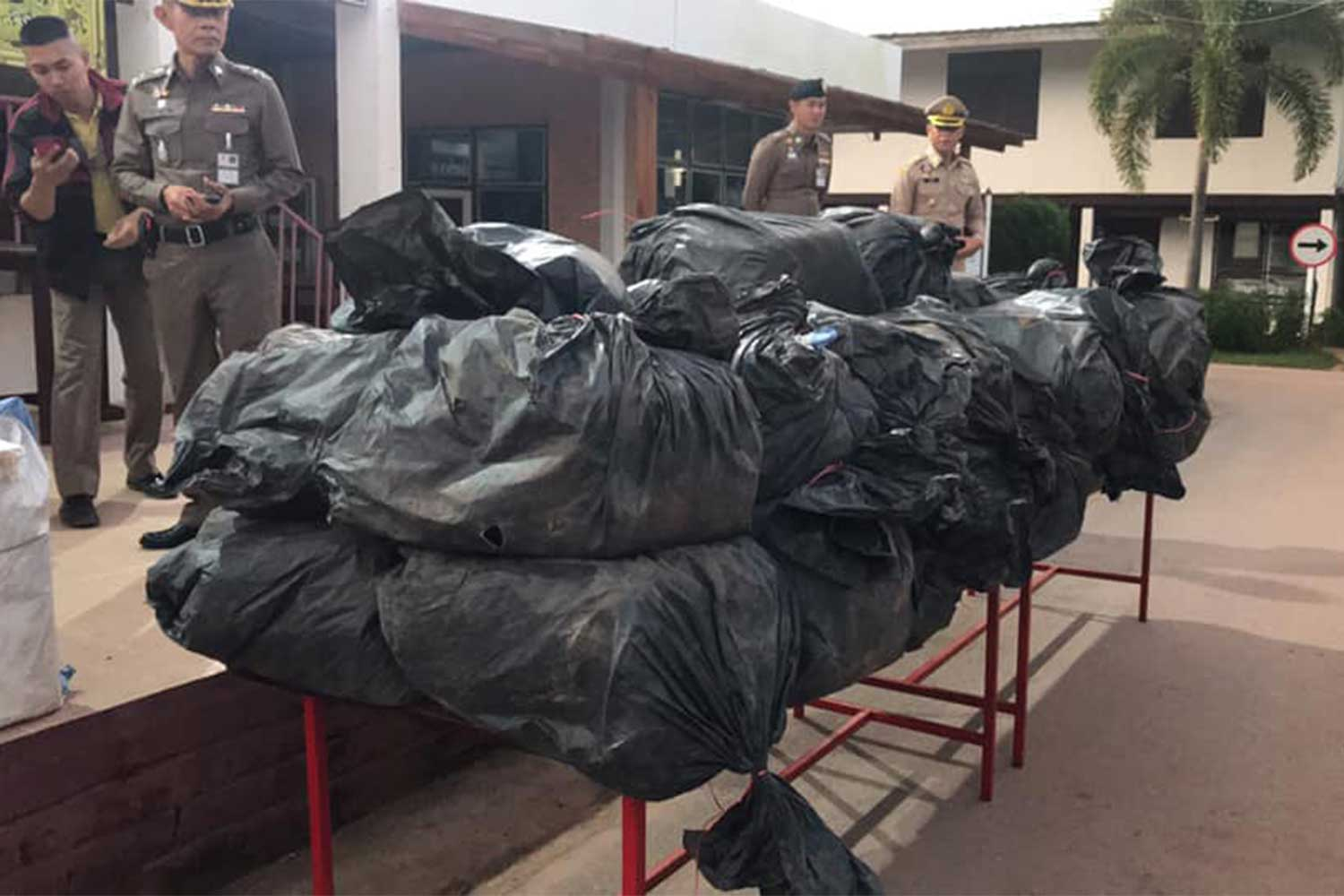 Plastic bags contain 8 million meth pills, found at a garbage dump, on display at Dan Sai police station in Loei province on Monday. (Photo from @armyprcenter Facebook page)