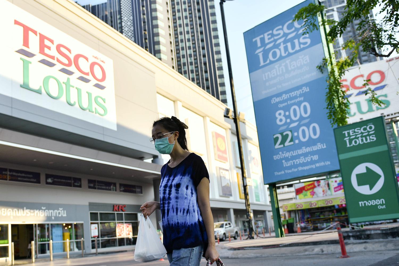 A shopper walks past a Tesco Lotus superstore in Bangkok. (Reuters File Photo)