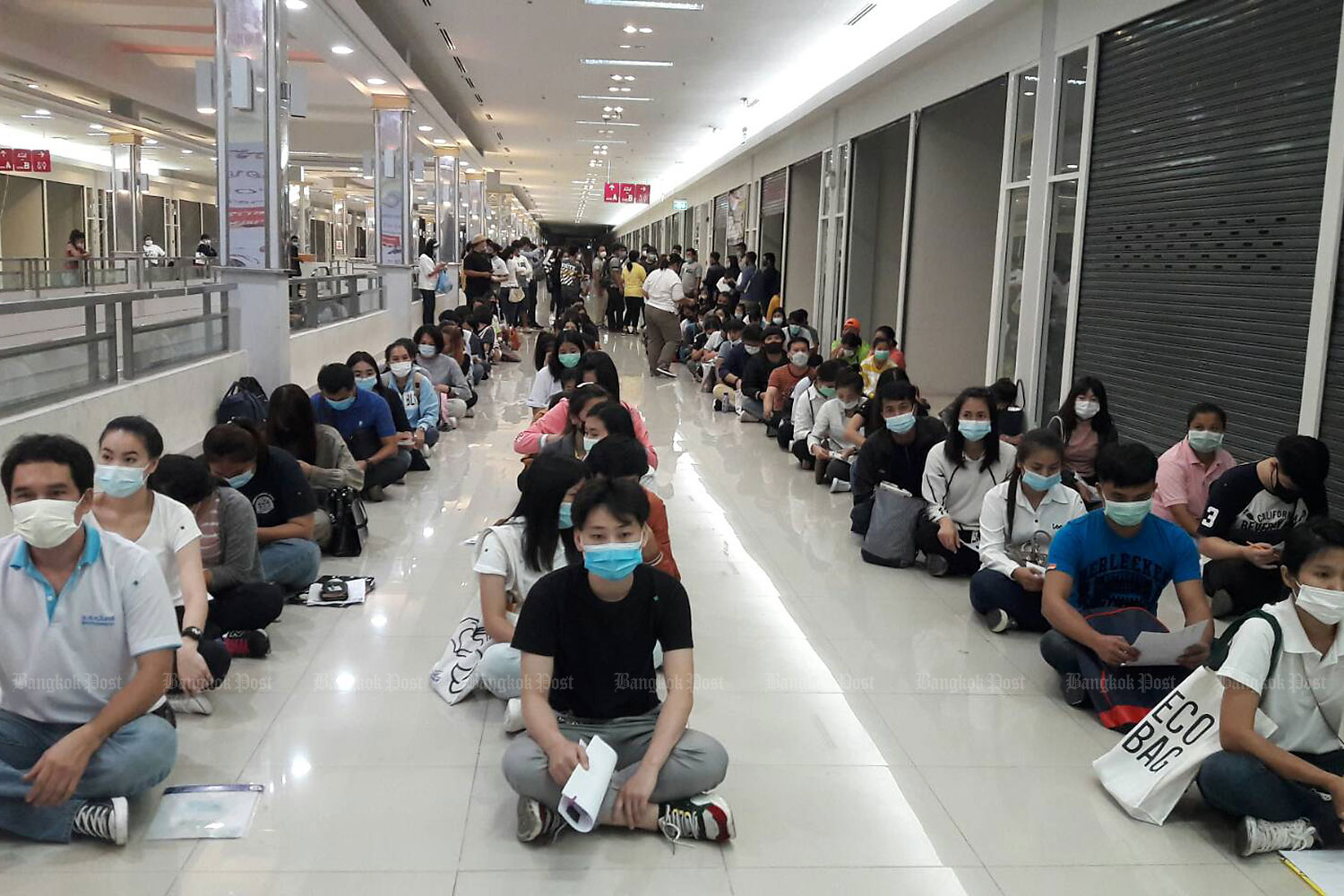Job aspirants turn up at the Hub Rangsit in Pathum Thani on Oct 28 to apply to take a standardised Korean language test required for foreign workers seeking jobs in South Korea under the Employment Permit System of the government-to-government labour export quota. (Photo by Penchan Charoensuthipan)