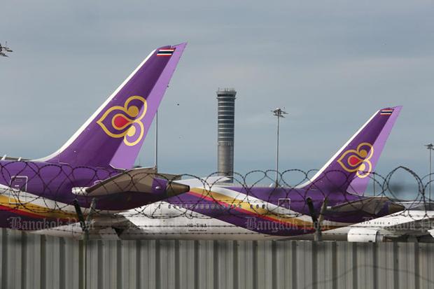 Thai Airways International planes sit idle at Suvarnabhumi airport. (Photo: Somchai  Poomlard)