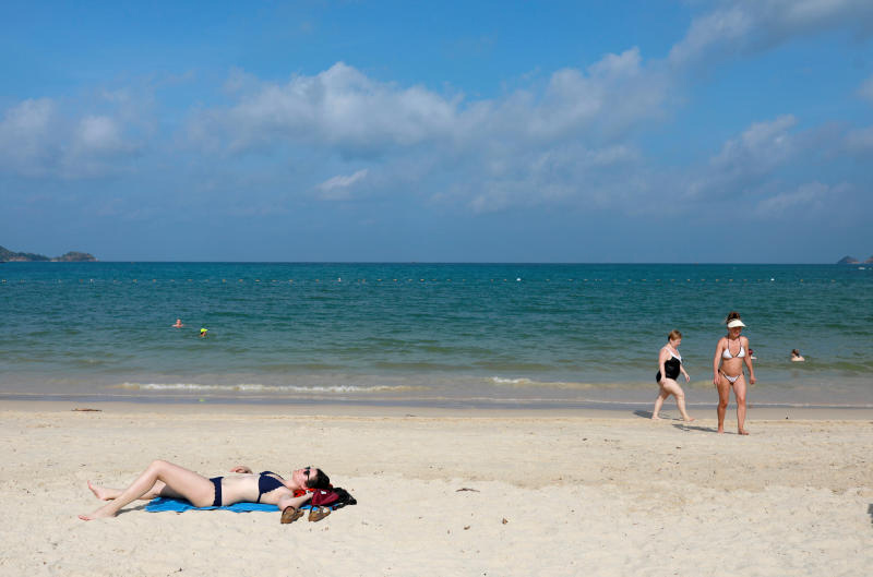 A handful of Western tourists seen on a beach in Phuket on March 10. The place is usually full of Chinese tourists. Overseas investors are returning to Thai financial markets due to optimism that the government will soon reopen for mass tourism. (Photo: Reuters)