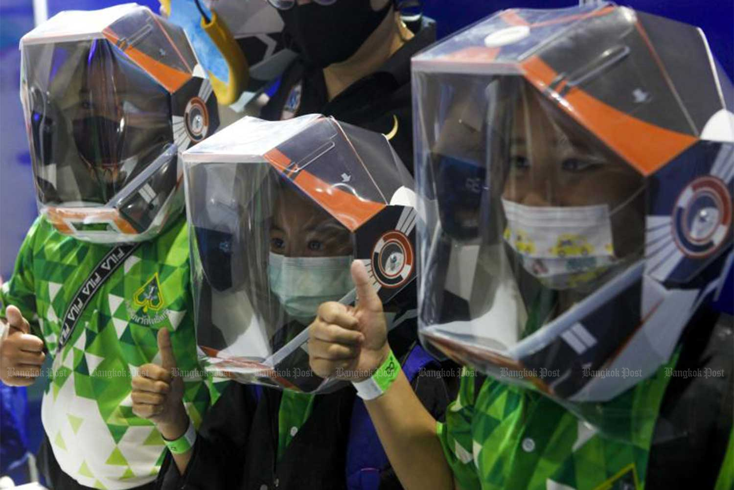 Students wearing face masks and face shields as they take part in a 'negative pressure helmet' workshop at the National Science and Technology Fair 2020 on Friday. The event is held until Nov 23 at Impact Muang Thong Thani. (Photo: Pattarapong Chatpattarasill)