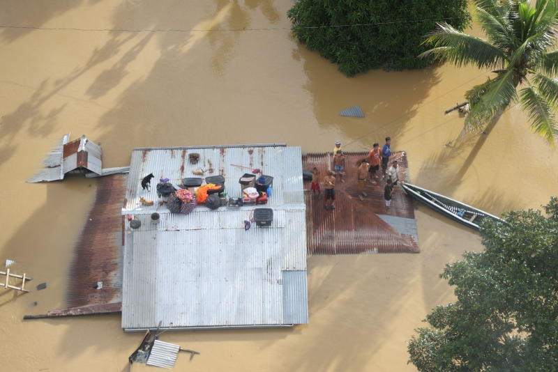 People wait to be rescued as they stand on a roof of a building, after Typhoon Vamco resulted in severe flooding, in the Cagayan Valley region in the Philippines on Saturday. (PHILIPPINE COAST GUARD/Handout via REUTERS)