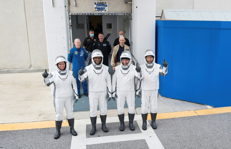 NASA astronauts Shannon Walker (left), Victor Glover (2nd left), Mike Hopkins (2nd right) and Japan Aerospace Exploration Agency (JAXA) astronaut Soichi Noguchi (right), are pictured wearing SpaceX spacesuits in a dress rehearsal ahead of the Crew Dragon launch.