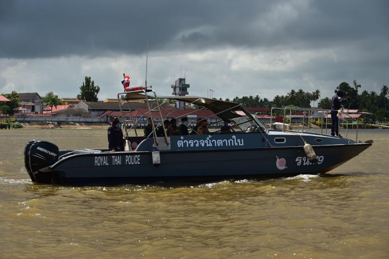 A Royal Thai Police boat is pictured during a joint police and army river patrol along the Thailand-Malaysia border in Takbai district in the southern province of Narathiwat on Sunday, as authorities sought to prevent illegal entries. (AFP photo)