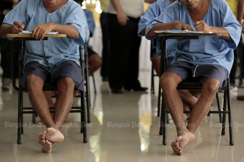 Inmates of  Bangkok Remand Prison attend a writing class in July 2019 under a programme to equip them for life after they are released and discourage recidivism. The Corrections Department's plans for factory estates at prisons will provide much greater opportunities for job training. (Bangkok Post file photo)