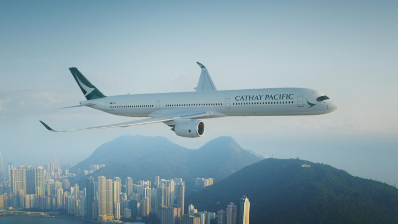 A Cathay Pacific plane is seen in front of an air traffic control tower at Hong Kong International Airport, Hong Kong, Oct 24 2020. (Reuters file photo)