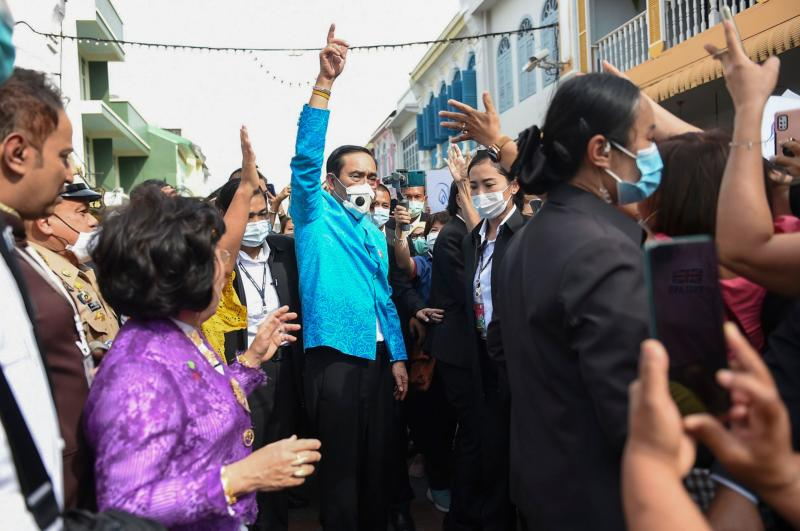 FILE PHOTO: Prime Minister Prayut Chan-o-cha wears a face mask while gesturing to a crowd during a visit to Phuket, to revive the tourism industry affected by the Covid-19 novel coronavirus pandemic, on Nov 3, 2020. (AFP photo/Royal Thai Government)