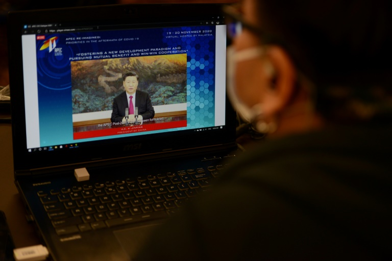 Xi Jinping makes a online address to the Apec summit, promising